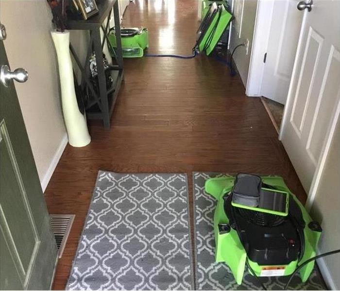 air movers placed on floor hallway