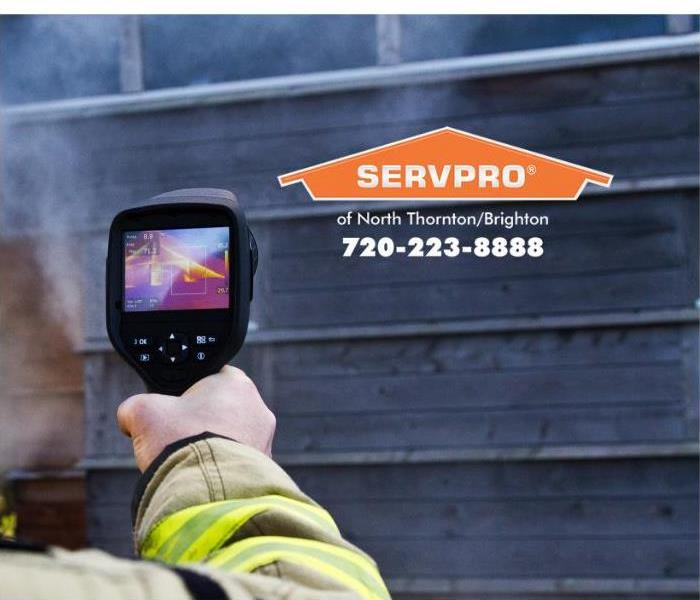 An infrared camera is being used to detect the heat signature inside of a building.