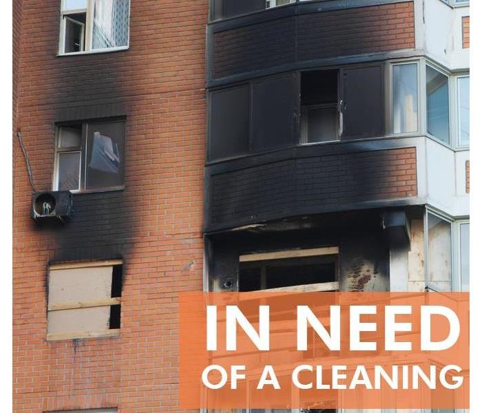 Building exterior burned out partially - Text in picture that says IN NEED OF A CLEANING